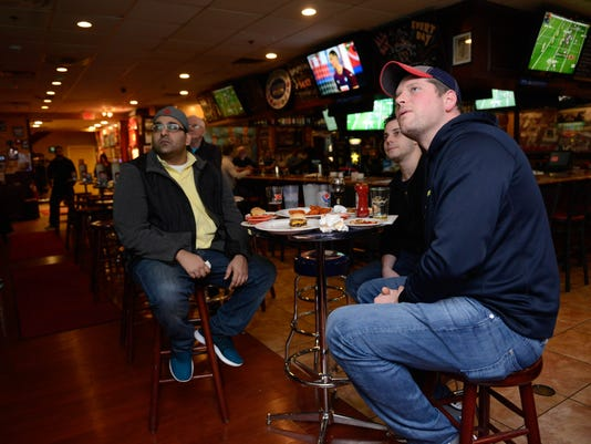 Fans watch football at Redd's