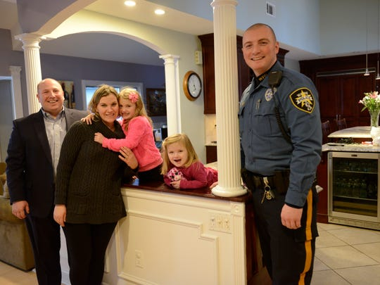 Wayne Police Officer Brian Hackett with Paul and Elizabeth Morisco and their daughters, Gianna, 5, and Nicole, 3.
