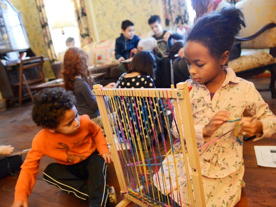 Gwen and Terry Demming, 8 and 5, of Montclair, learn to weave during the Presidents' Day for Kids program at the Crane House in Montclair on Feb. 20, 2017. Participants made arts and crafts, went on scavenger hunts and witnessed how a home operated during the Revolutionary era.