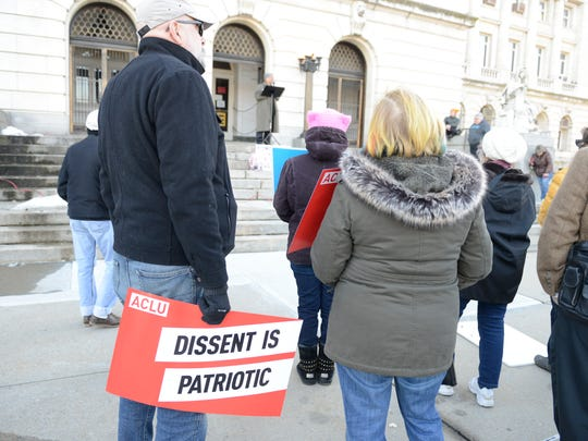 """Protesters gather on the steps of the Bergen County Courthouse in Hackensack on Feb. 20, 2017, Presidents' Day, during the """"New Birth of Freedom"""" vigil."""
