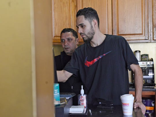 Owner of Amir Restaurant Mohammed Ziyadeh of Fairview helps an employee at his restaurant on Feb. 21, 2017. Ziyadeh spoke to The Record about President Trump's plan to deport all immigrants saying he thinks it is unfair and that immigrants help the country, not harm it.