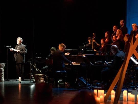 Vocal Arts Ensemble singer Thom Mariner narrates, with composer Craig Hella Johnson at the piano, with a representation of the fence that Matthew Sheperd died on during a VAE performance at Xavier University.