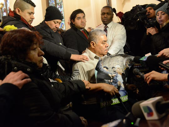 Catalino Guerrero surrounded by his family, sitting in Grace Episcopal Church on Friday.