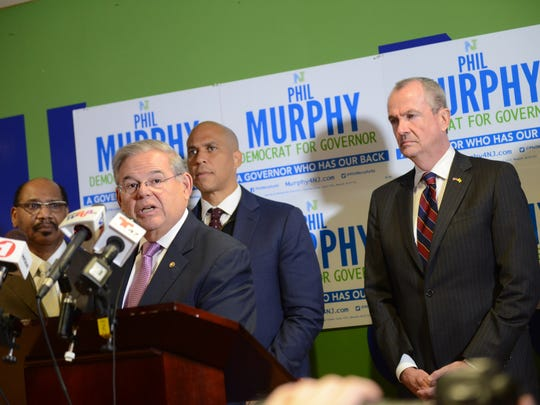 Sen. Bob Menendez endorses gubernatorial candidate Phil Murphy, right, at the Murphy for Governor field office in Newark in January. Menendez and Sen. Cory Booker, center, both gave Murphy their stamp of approval for New Jersey's highest office.