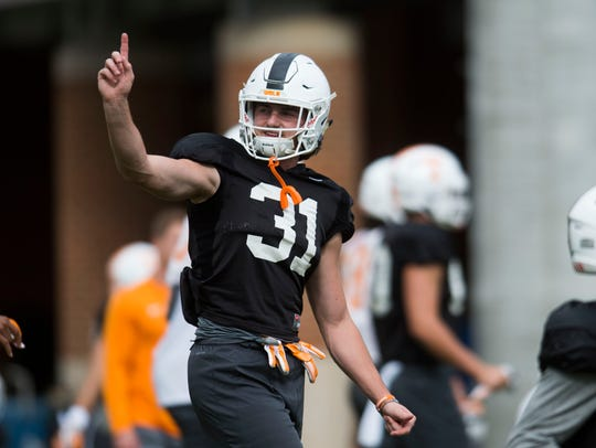 Tennessee H-back Parker Henry (31) stretches during