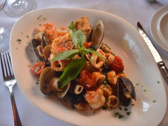 Black squid ink pasta at restaurant Grissini in Englewood
