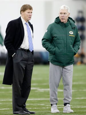Green Bay Packers President and CEO Mark Murphy (left) talks with Ted Thompson during the team's practice at the Don Hutson Center on Dec. 20, 2017.