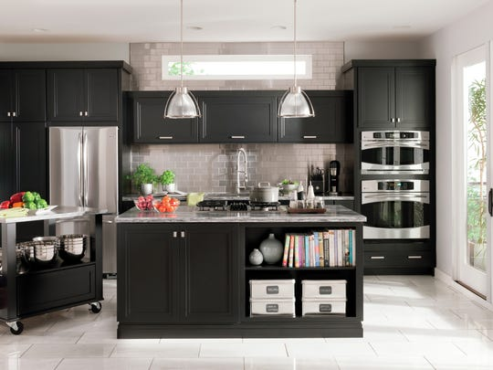 """This photo provided by Home Depot shows two islands, instead of one, offering plenty of space in a super kitchen. The era of the """"super kitchen'' has arrived, say interior designers and trend-watchers: People are building or remodeling kitchens that include work and entertainment space, too. (Home Depot via AP)"""