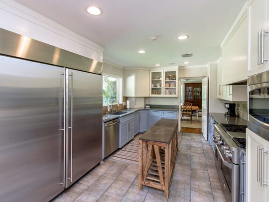 The kitchen includes a commercial grade refrigerator