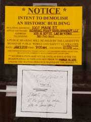 A sign posed on the front door announces the intent to demolish the building that formerly housed R&M Market Monday, January 8, 2018, at 1007 Main Street in Lafayette. Another hand written note, thanks R&M Market customers for their years of patronage.