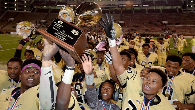Bassfield celebrates its third straight Class 2A State Championship in this 2014 file photo.