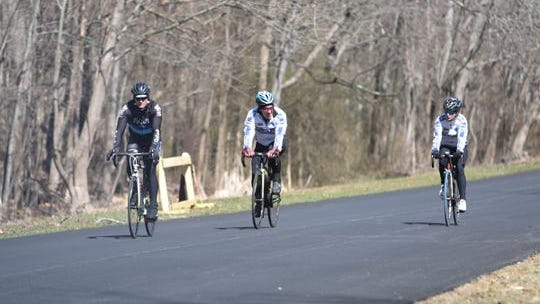 Cyclist ride aoong the outter road at Rockland Lake in Congers on Saturday, March 21, 2020.