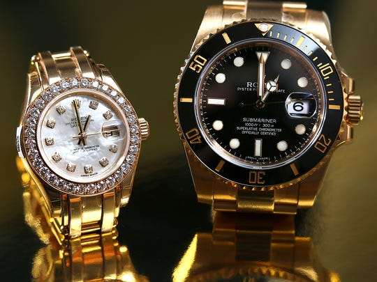 His and her gifts. Rolex offers many styles like this Sub Mariner 18 karat yellow gold $34,250 for him. And for her, a Pro Master 18 karat yellow gold with diamond bezel and mother pearl diamond dial for $47,450.