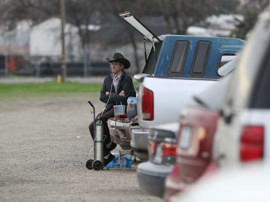 Lynn Stockade, 70, of Oroville watches people pass by Monday at the Silver Dollar Fairgrounds in Chico. Stockade and other members of his family arrived Monday morning to the shelter for evacuees from the affected areas.