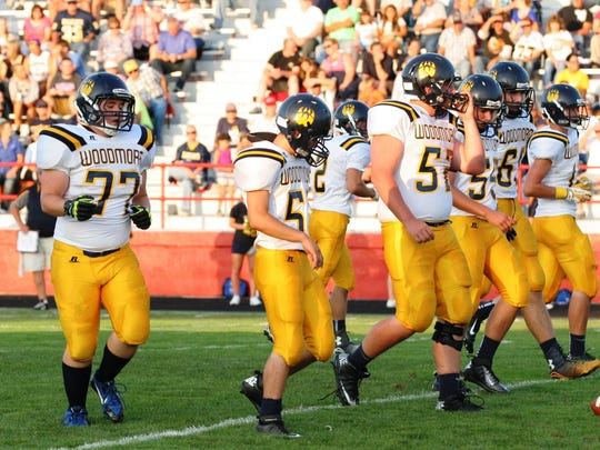 The Woodmore offensive line approaches the line of scrimmage during the Wildcats' 2014 season-opener at Port Clinton.