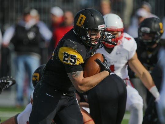 DePauw's (25) James Deaton runs the ball during the