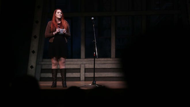 Des Moines Register reporter, Courtney Crowder introduces the storytellers during the Des Moines Storytellers Project: Love and Heartbreak event on Tuesday, Feb. 16, 2016, at the Des Moines Playhouse.