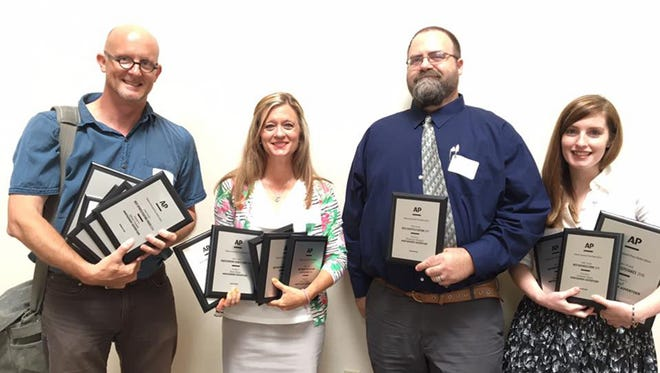 From left, Montgomery Advertiser staff members Mickey Welsh, Kym Klass, Shannon Heupel and Taylor Ford hold awards won by the Advertiser on Saturday at the Alabama Associated Press Media Editor awards banquet in Birmingham.