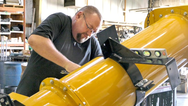 Jim Schorzman works on a conveyor at Shield Agricultural Equipment in South Hutchinson.
