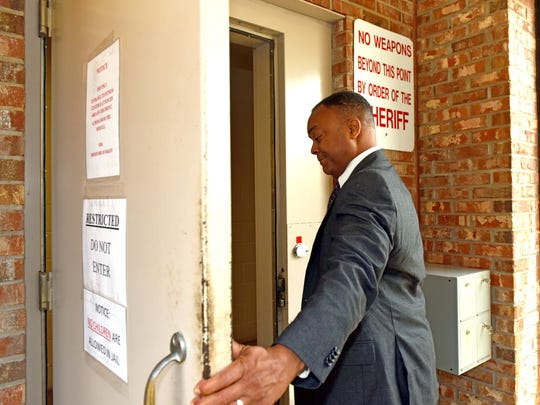 Hinds County District Attorney Robert Shuler Smith enters the Rankin County Jail in May as he turns himself for felony charges of aggravated stalking and robbery.