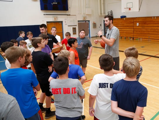 Zach Lydon speaks with campers ,before they break for