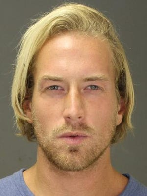 This Sept. 2014 photo provided by the Suffolk County District Attorney's office shows Thomas Gilbert Jr., after his arrest on Sept. 18, 2014 in the town of Southampton, N.Y., on a misdemeanor charge. On Monday, Jan 5, 2015 police arrested Gilbert, 30, on a murder charge after they say he went to his father's Manhattan apartment Sunday afternoon, shot him in the head after an argument about money, and  tried to make it look like a suicide.  Seventy-year-old Thomas Gilbert Sr. was a founding partner at hedge fund Wainscott Capital. (AP Photo/Suffolk County District Attorney's office)