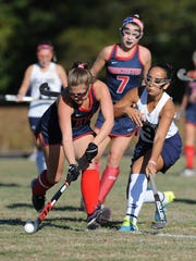 Holly Grove's Madison Monzo defends as Worcester Prep's