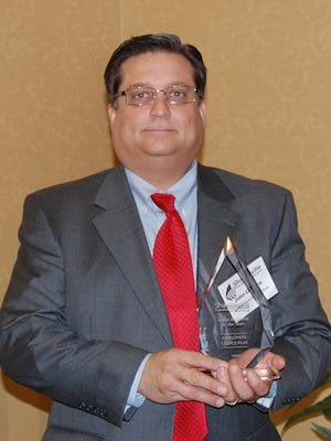 John Cacaro, former owner of Employers Choice Plus, accepted the company's 2009 Sharonville Chamber Large Business of the Year award from the Sharonville Chamber of Commerce.
