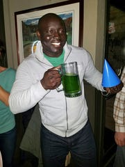 Christian Diompy celebrates his 39th birthday - on St. Patrick's Day - with green beer, while he was also undergoing chemotherapy treatments for Stage 4 esophageal cancer. Courtesy of Diompy family