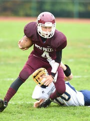 New Paltz's Jimmy Verney breaks pulls out of a tackle
