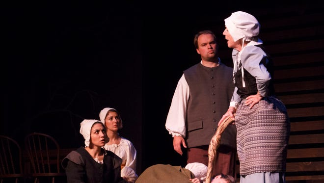 "The cast of ""The Crucible"" rehearses before their Friday opening."