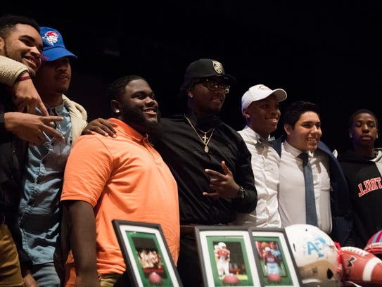 Signees at Austin-East pose for a group photo during