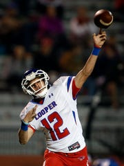 Abilene Coopers' Austin Smith (12) passes the ball during the football game against Coronado, Thursday, Nov. 3, 2016, at Lowry Field in Lubbock, Texas.
