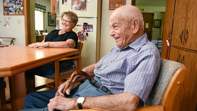 Diane Jensen, 68, Melrose, laughs with her dad Ken Rudolph, 98, Annandale, as they reminisce Thursday, June 2, 2016, in the family home on a farm near Annandale.