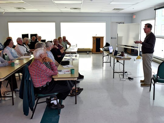 Driving instructor Ron Stewart gives a refresher course to drivers over 55 last week at the Whitney Senior Center.