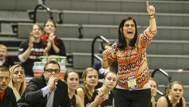 Marine City Cardinal Mooney head coach Susan Everhart talks to her team in March 2014.