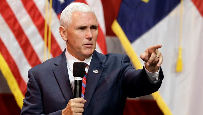 Republican Vice presidential candidate, Indiana Gov. Mike Pence takes question during a town hall meeting in Raleigh, N.C., Thursday, Aug. 4, 2016.