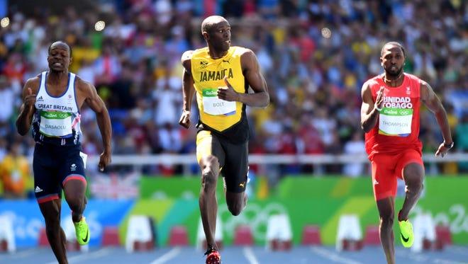 Usain Bolt breezes in his 100 heat.