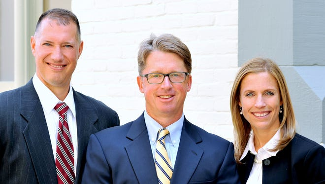 Attorneys Adam Gee, left, Jim Reed and Christina Sonsire of Elmira's Ziff Law Firm have been named Super Lawyers for upstate New York.