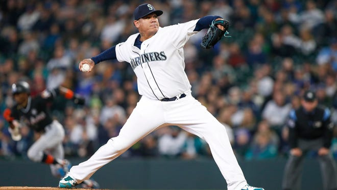 Mariners starter Felix Hernandez delivers a pitch against Miami in the first inning Wednesday at Safeco Field.