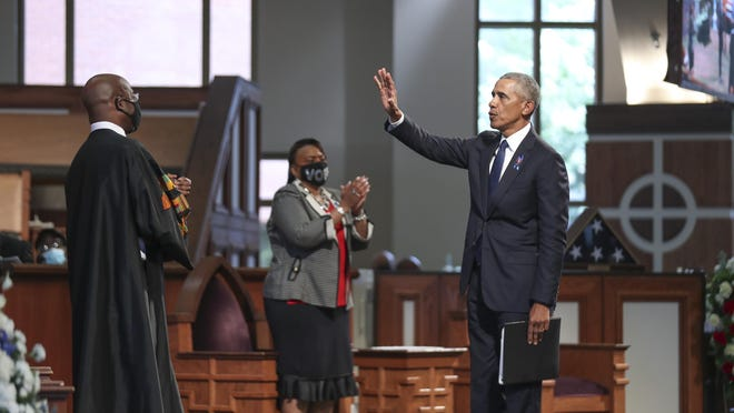 "7/30/20 - Atlanta, GA -  Former President Barack Obama waves to the crowd after he delivered the eulogy.  On the sixth day of the ""Celebration of Life"" for Rep. John Lewis, his funeral is  held at Ebenezer Baptist Church in Atlanta, with burial to follow.   Alyssa Pointer / alyssa.pointer@ajc.com"