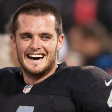 Aug 28, 2014; Oakland, CA, USA; Oakland Raiders quarterback Derek Carr (4) smiles on the sideline during the second quarter of the preseason game against the Seattle Seahawks at O.co Coliseum. Mandatory Credit: Ed Szczepanski-USA TODAY Sports