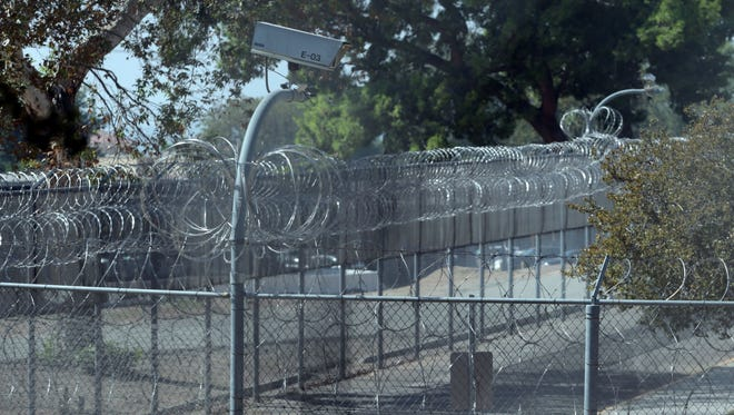 The security fence at Patton State Hospital in Patton, CA on Tuesday, October 14, 2014. The facility is the country's largest forensic mental hospital serving the criminally insane.