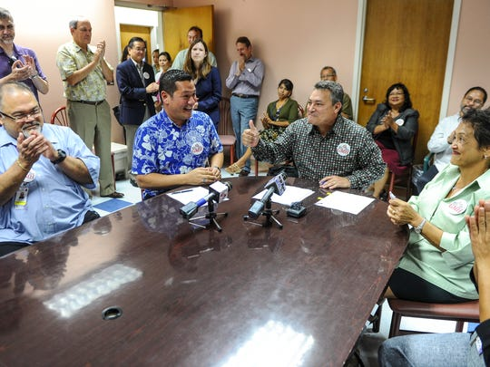 In this Aug. 17, 2016, file photo, Gov. Eddie Calvo gives a thumbs up after the signing of a limited obligation bond at the Guam Memorial Hospital in Tamuning.
