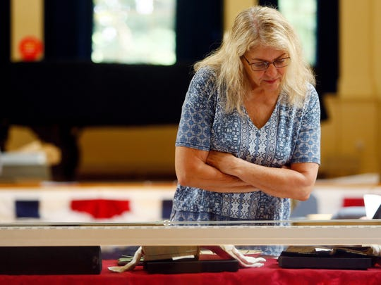 Janet McDonough of Randolph looks at  items from the archives and collections associated with American presidents and their first ladies  at the museum at Morristown National Historical Park before a talk by Dr. Jude Pfister, Chief of Cultural Resources and author. July 28, 2018. Morristown, NJ