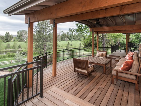 This second-story covered deck in south Fort Collins has lounge seating and a raised dining area.