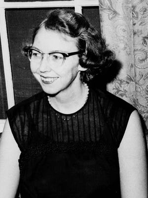 Author Flannery O'Connor is seen in the 1962 photo.