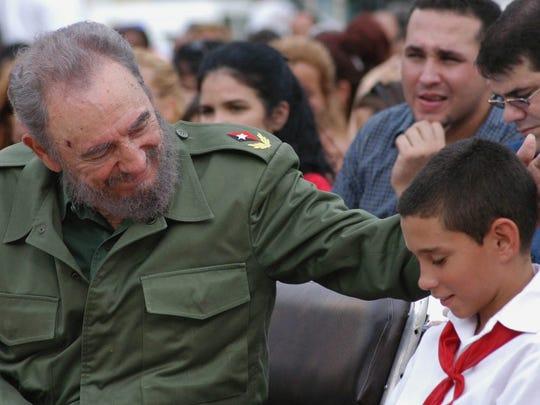 Fidel Castro with Elian Gonzalez .