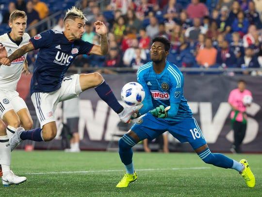 New England Revolution forward Diego Fagundez tries