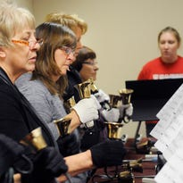 The St. Boniface bell choir rehearses on Thursday, Oct. 29, in the choir room at St. Boniface church. The bell choir is practicing different Christmas carols for the holiday season.